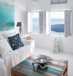 Mediterranean Greek Santorini Living Room Decor. Simple Whitewashed Mediterranean Decor Style. Featured on Completely Coastal: https://www.completely-coastal.com/2018/04/santorini-mediterranean-decor-idea-living-room.html Beach Cottages, Black Leather, Gallery Wall, Black Patent Leather, Beach Houses