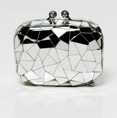 Yes - please! Silver clutch <3 With a vintage look and very luxurious, this bag is a real gem. Kotur cracked mirror clutch with Swarovski crystal closure, $899 koturltd.com #bag #handbag #clutch
