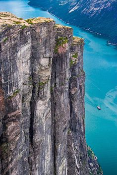 Kjerag, Norway. Wish to be those on the cliff top!