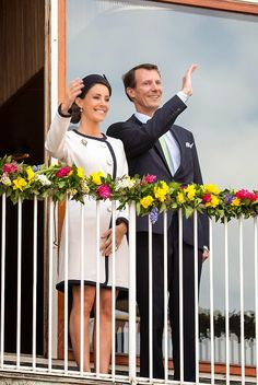 Princess Marie and Prince Joachim of Denmark wave to a cheering crowd from the balcony of Aarhus Town Hall on 08.04.2015 in Aarhus, Denmark.