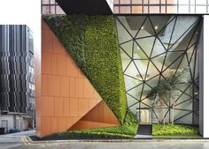 Street view of the urban pocket park and vertical green, Image Courtesy © Patrick Bingham-Hall