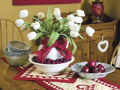 Use an antique wash set to host a spring bouquet, filling the bowl with berries and tying a bow onto the pitcher. To see more of this photo and find out more about the items shown, turn to page 135 of our May 2014 issue, www.countrysampler.com/craftfair. Preview the issue: http://www.countrysampler.com/issues/detail.php?issue_code=C0514 Buy the issue: http://www.samplermagazines.com/April_May_2014_Country_Sampler_Pre_sale_p/c514b001a.htm