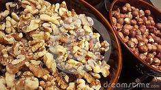 Walnuts, almonds in containers. Overhead. Foods rich in polyunsaturated fats and omega 3. Viewed from above.