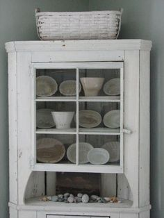 Vintage Pudding Moulds Displayed in White Hutch