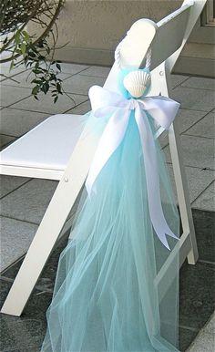 Tulle, rope, and seashell chair decor #BeachWeddingIdeas