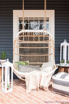 I would love to have this hanging chair to fall asleep in with my daughter! BECKI OWENS- 7 Ways to Spruce your Stoop. Up your curb appeal with these easy and affordable updates before summer guests arrive. Outdoor Rooms, Outdoor Living, Outdoor Decor, Outdoor Kitchens, Summer Porch Decor, Front Porch Design, Front Porch Seating, Diy Garden Furniture, Furniture Ideas