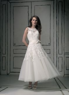 Justin Alexander wedding dresses style 8555 Sabrina sleeveless, laser cut flower/tulle, silk dupion cummerbund, bow/brooch, tulle tea length, keyhole, buttons over back zipper. (Floor length version- style 8580)