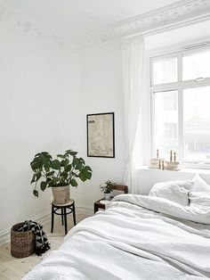 All white bedroom with modern vintage touch