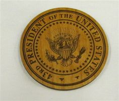 Wooden seal magnet, George W. Bush Presidential Library
