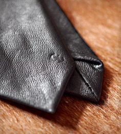 Nothing beats a noir Leather Tie $90