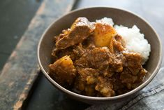 Jamaican Goat Curry Recipe Main Dishes with vegetable oil, curry powder, allspice, goat, salt, onions, habanero, ginger, garlic, coconut milk, tomato sauce, dried thyme, water, yukon gold potatoes