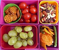 Crunchy veggie chips, grapes, cherry tomatoes, bite size crackers, fruit mix
