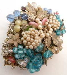 Signed Miriam Haskell floral brooch, beads, faux pearls, gold tone metal from 1stdibs.