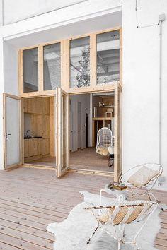 natural wood patio outside of modern home in barcelona. / sfgirlbybay