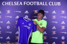 Luiz poses proudly with the Chelsea shirt after completing his transfer deadline day move
