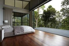 The aptly named Deck House is perched on a slope next to Malaysia's Janda Baik rainforest, so occupants who choose to pull back the sliding glass wall better be wary of snakes, monkeys and other tree-dwelling creatures.
