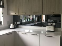 A Glasgow client contacted Intaglio Glass and Design as they wanted a mirror glass splashback to complete their new kitchen. Mirror Backsplash Kitchen, Mirror Splashback, Curved Glass, New Kitchen, Kitchen Sink, Glass Design, Colored Glass, Kitchen Remodel, New Homes