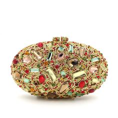 Your lipstick, keys and phone find a chic home in this petite clutch purse from Milanblocks.Beautifully designed in Colorful Oval Diamond Wedding Purses, this date night favorite is highlighted by bri