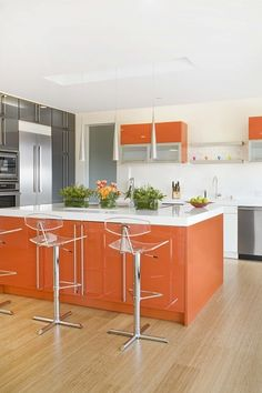 My kitchen is the reverse - designed in the 70s.  Formica orange counter tops, white cabinets - how to make it look this updated?  Like the grey but my floor is a dark brown hexagon terra cotta tile.