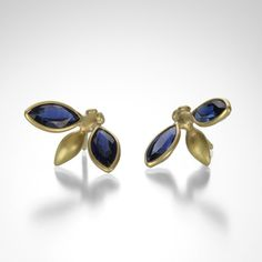 "These Gabriella Kiss ""Gem Bug"" stud earrings are a wonderful example of the humor and whimsy often found in her work. The 3 dimensional shape gives the sense that the bugs are alight on your ears. The studs are carefully crafted of an 18k gold body, with marquis shaped, dark blue sapphire wings. @QUADRUM"