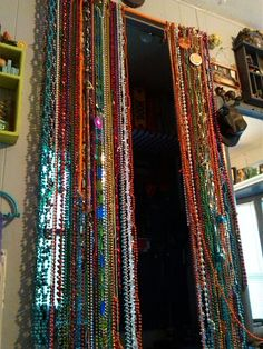 Beaded curtain.diy... Mardi gras beads curtain rod...time, still working on it...