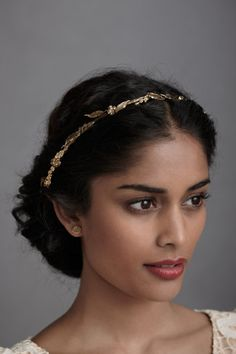 Love the gold headband. (If that's a leaf pattern, it's vaguely reminiscent of the laurel crowns of classical Rome.)