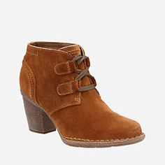 This ankle bootie from the Clarks® Artisan Collection is perfect with skinny jeans and fluffy socks for a winterized casual look. The Carleta Lyon oozes with Clarks® DNA in premium tan suede, a weathered look on the toe and heel and classic craftsmanship details like pintuck stitching and a Ghillie lace fastening. A comfortable <a href=/about-clarks/cushion-plus>Cushion Plus™ </a> with OrthoLite® footbed and durable fleck rubber heel and outsole make every step a breeze.