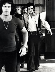 Elvis Presley with bodyguards at the Hilton Hotel, Philadelphia,1974. Photo by Ron Galella.