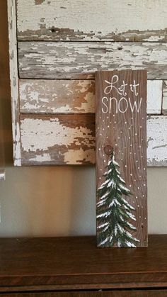 Christmas Winter Reclaimed Wood Pallet Art, Let It Snow, Hand painted Pine tree,Christmas decorations, upcycled shabby chic, Original Acrylic painting on reclaimed pallet boards.  This unique piece is 5 1/2 x 19 tall. It is a fun, personal touch to add to your Christmas decor or a great gift for teachers.  All of my creations are made of reclaimed boards. They are hand painted and are made after they are ordered.  Although I try to duplicate original as closely as possible, there may be…