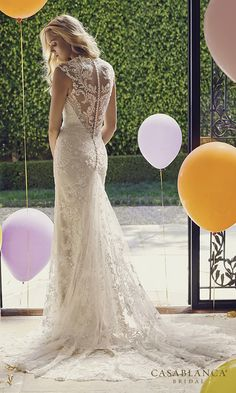 wedding dress features stunning floral lace throughout its design.