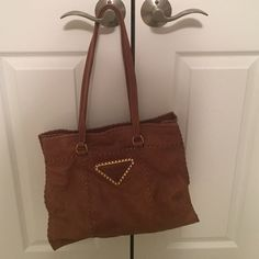 Brown leather Prada bag Brown leather bag with large stitching. Good condition, authentic. Was purchased from a Prada trunk show. Some wear from use. Price is negotiable. Prada Bags Shoulder Bags