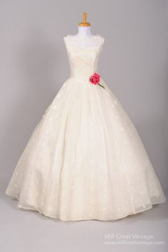1950's Southern Bell Vintage Wedding Gown - sweetheart neckline with full bell skirt in silk taffeta. The overlay of fine embroidered netting is sleeveless with boat neckline. The overlay also falls over the full skirt.