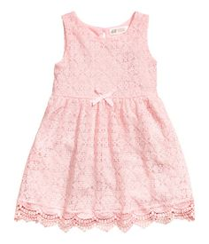 Light pink. Sleeveless dress in soft, cotton-blend lace. Opening with button at back of neck, seam at waist, and gathered skirt. Jersey lining.