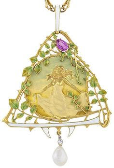 A French Art Nouveau 18 karat gold pendant with pink sapphire, diamonds and pearl by Lucien Gautrait. The pendant shows an emergent woman with flowing hair and outstretched arms. Circa 1900.
