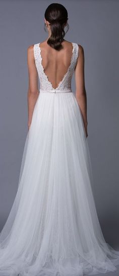 Elegant v-shaped back wedding dress with tulle A-line skirt; Featured Dress: Lihi Hod