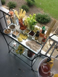 Bloody Mary Bar: variety of vodka (Absolut, Tito's and Southern Son); Zing Zang mix and tomato juice; Tabasco Sauce and Worcestershire;  olives, bacon, jerky, celery, pickles, and pickled okra; salts (celery, hot, sea salt), pepper and Bloody Mary spice / salt mix.