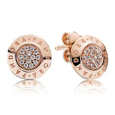 The stylized logo modernizes these essential stud earrings while the cz pavé details and pink shade add a glamorous and romantic touch.<br><br><i>Luminous and elegant, PANDORA Rose™ jewelry combines a unique blend of metals to capture new and unforgettable moments in warm pink-hues.</i><br> <br>  <b> Style: </b> 280559CZ