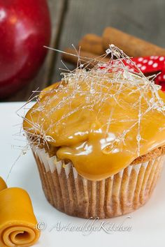 Apple Cupcakes with a chewy caramel topping decorated with spun sugar.