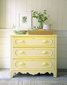 Yellow. Have had this page folded down in an old Martha Stewart Living magazine forever. Always have loved the drawer pulls and color
