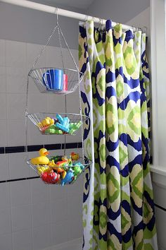 metal hanging fruit basket over the shower curtain rod to hold  toys {mmm great tip but seems you would need to air out that curtain too.} - Have one of those going to waste right now! ;) Organisation Hacks, Bathroom Organization, Organizing Tips, Organizing Kids Toys, Storage Organization, Organized Bathroom, Household Organization, Toy Storage Solutions, Storage Ideas