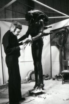 H.R. Giger prepares the model for Alien (1979)