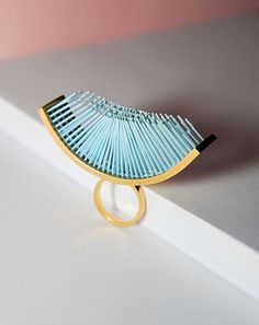 Evgenia Balashova. Ring: Fiber Ring 2, 2018. Light blue 3d printed nylon and 18ct gold plated sterling silver ring.. UK M, US 6.5.