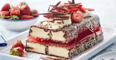 Invite your family and friends over for a good ol' Aussie favourite with this delicious lamington cake, layered with strawberry jelly and whipped cream.