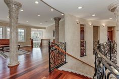 Traditional Staircase with Wall sconce, Hardwood floors, High ceiling, Metal staircase
