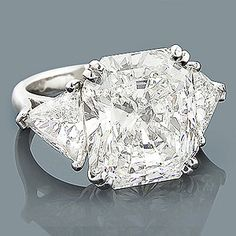 Platinum Engagement Rings: This Expensive Diamond Ring showcases a magnificent 10.02-carat, EGL-certified (EGL 54645301D) radiant cut diamond (I color; SI1 clarity) in the center and 2 trillion cut diamonds on the sides totaling 2 ctw. This luxurious 3 stone diamond engagement ring is absolutely breathtaking!