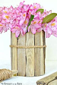 how to make a jar vase | Hot glue driftwood pieces around a Jar , then add a finishing touch ...