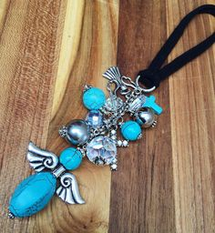 Rear View Mirror Charm - Car Accessories for Women - Cute Car Decor Guardian Angel Charm Cluster Colors: Turquoise Silver Charm Cluster Size: 5 inches (130mm) Nylon Band 5 inches Charm Cluster includes: 2 inch (50 mm) Hand Beaded Angel Made from Silver Angel Wing Charm and Turquoise