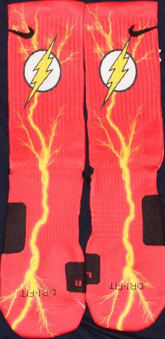 Please note: Our graphic designer has 19 years experience in the industry. He works to achieve perfection. Some sock designs may take six to eight hours to create. The entire sock is covered and there is very minimal white lines if any. The reason for our price is that we use the highest quality of paper and ink. These socks will last a long time where others will fade. You get what you pay for with our company.These are the 2014 Flash Gordan Inspired Custom Nike ElitesSI...