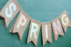 SPRING burlap banner. $36.00, via Etsy. Could make with paper bags and scrapbook paper letters.