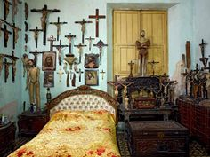 A home in Cuba - love the collage of crucifix's although I would do vintage crosses instead
